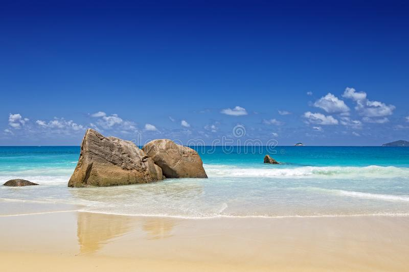 Gentle waves and rocks on tropical beach Seychelles royalty free stock photos