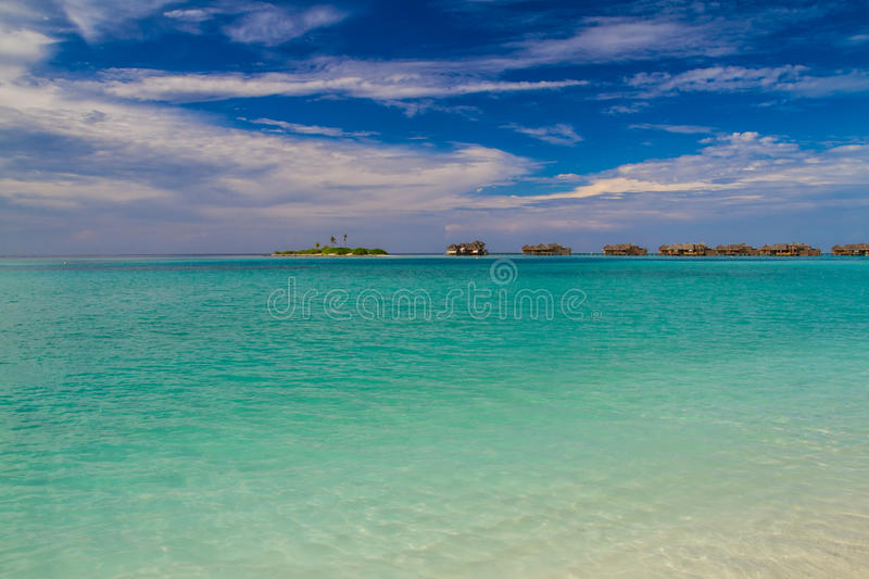 Beautiful tropical beach with water bungalows in Maldives stock photos