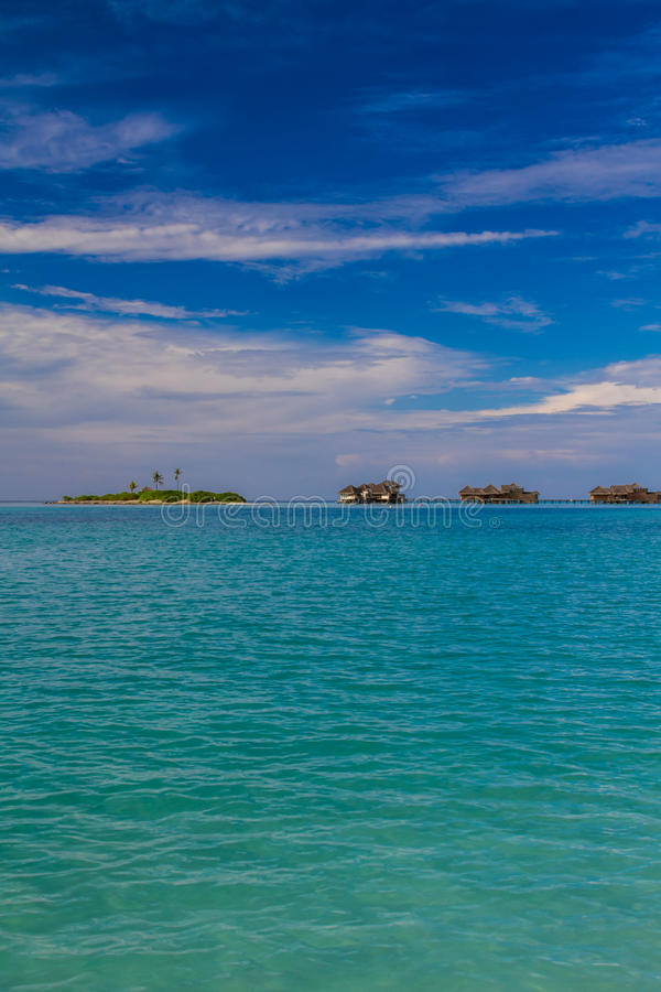 Beautiful tropical beach with water bungalows in Maldives royalty free stock photography