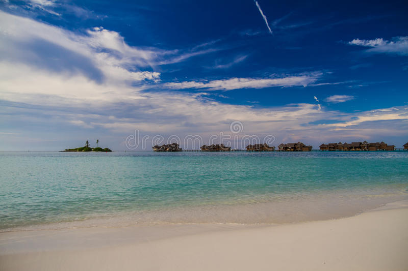 Beautiful tropical beach with water bungalows in Maldives royalty free stock photos