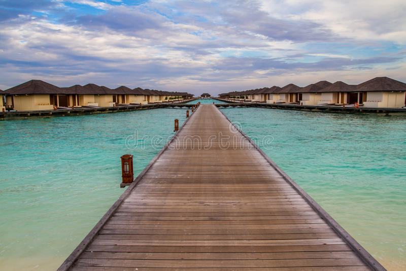 Beautiful tropical beach with water bungalows in Maldives stock images