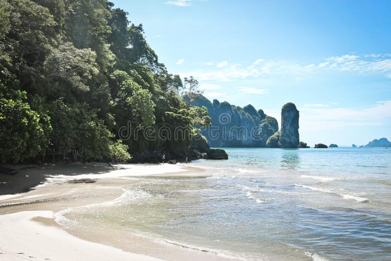 Beautiful tropical coast of Thailand overlooking the beach, azure sea and high steep cliffs, Krabi, Ao Nang stock image