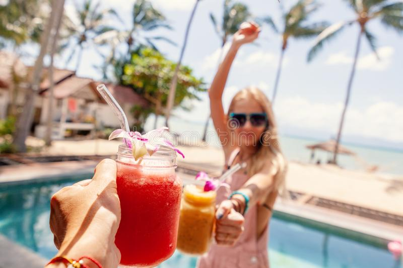Tropical cocktails cheers woman. Healthy drink. Celebration and tropical party. Beautiful with tropical cocktails cheers woman. Celebration party. Summer beach stock photo