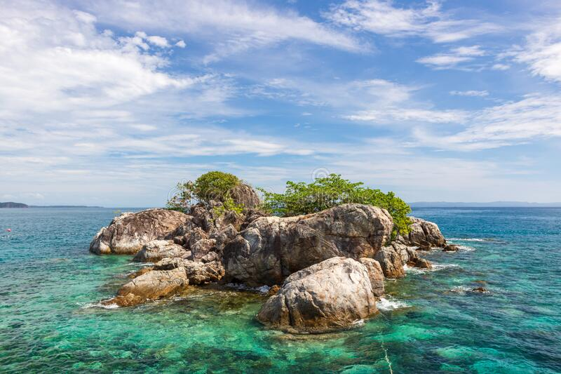 A beautiful tropical island in thailand and blue sky. Beautiful tropical island in thailand and blue sky royalty free stock images