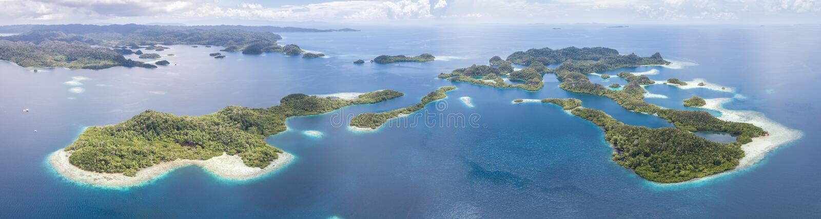 Aerial View of Tropical Islands in Raja Ampat. The beautiful tropical islands of Pef are surrounded by calm seas in the equatorial seascape of Raja Ampat stock image