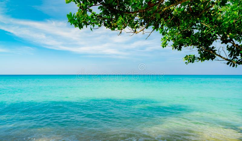 Beautiful tropical paradise beach background. Summer vibes. Summer vacation time background. Ocean waves. Calm, tranquil and relax. Scene. Emerald green sea royalty free stock images