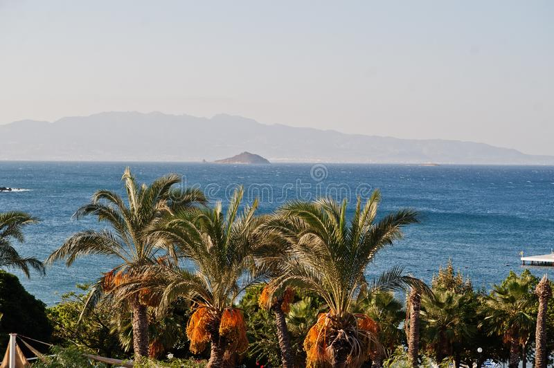 Beautiful tropical sea bay with palms. Scenic landscape with mountain islands and blue lagoon on Aegean sea. Exotic scenery. stock images
