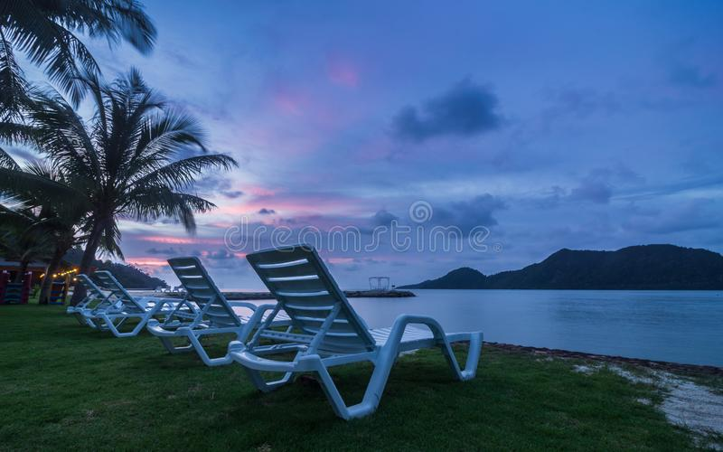 Beautiful tropical seascape view of Koh Chang, Thailand. Evening sun set view seaside and beach chairs. Vacation and holiday on stock image