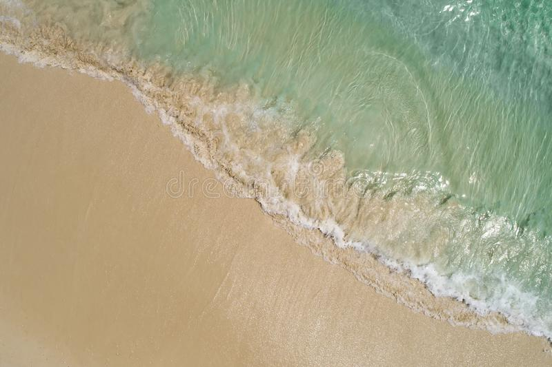 Beautiful tropical white empty beach and sea waves seen from above. Seychelles beach aerial view.  royalty free stock image