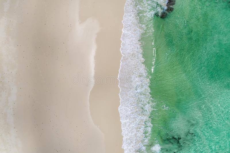 Beautiful tropical white empty beach and sea waves seen from above. Seychelles beach aerial view royalty free stock photo