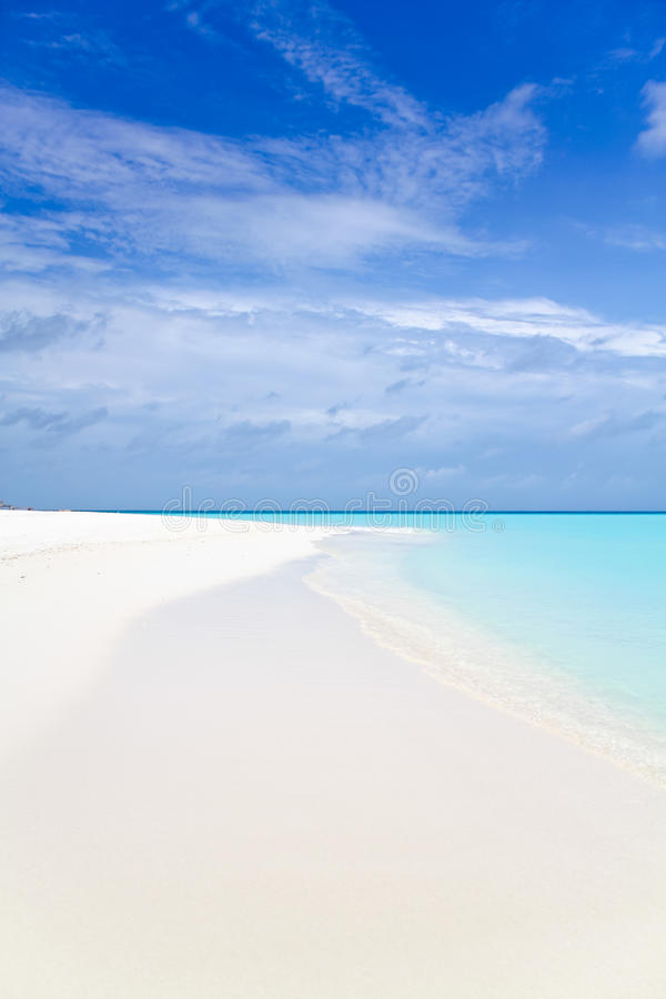 Beautiful tropical white sand beach And blue sky. Beautiful tropical white sand beach of Maldives, pure water of ocean and blue sky stock images