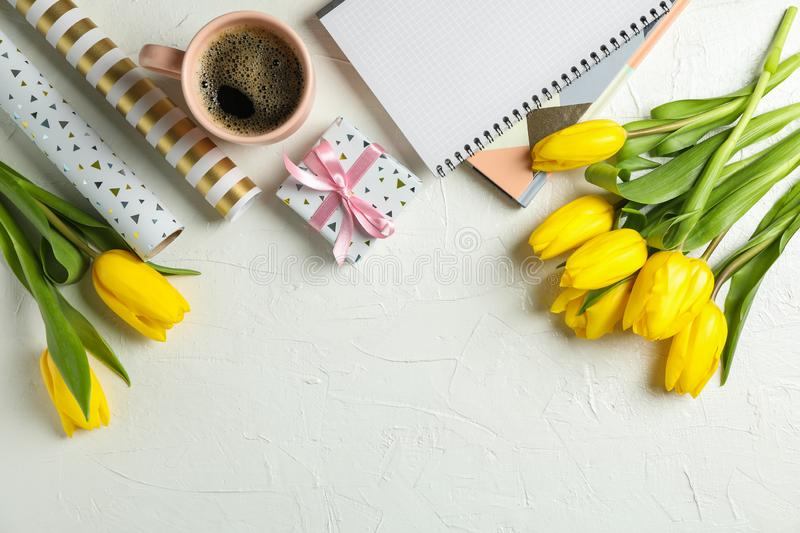 Beautiful tulips, copybooks, present and cup of coffee royalty free stock photo