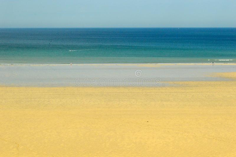 Porthkidney Sands Hayle Estuary, Hayle Cornwall England. Beautiful turquoise and blue sea and golden sand, grassy sea dunes and sunny summers day at Hayle royalty free stock image