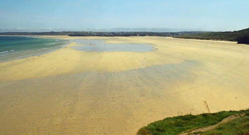 Porthkidney Sands Hayle Estuary, Hayle Cornwall England. Beautiful turquoise and blue sea and golden sand, grassy sea dunes and sunny summers day at Hayle royalty free stock photography