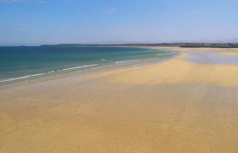 Porthkidney Sands Hayle Estuary, Hayle Cornwall England. Beautiful turquoise and blue sea and golden sand, grassy sea dunes and sunny summers day at Hayle stock photography
