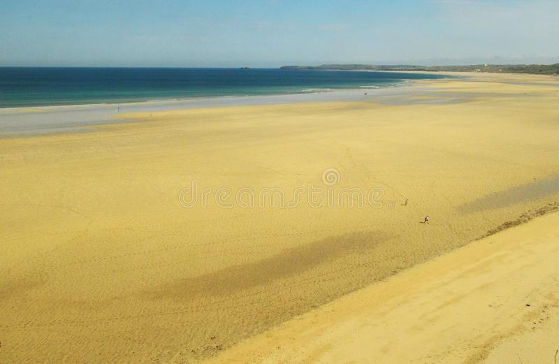 Porthkidney Sands Hayle Estuary, Hayle Cornwall England. Beautiful turquoise and blue sea and golden sand, grassy sea dunes and sunny summers day at Hayle royalty free stock images