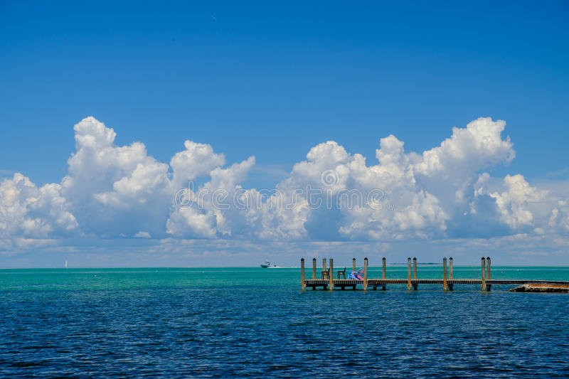 The beautiful turquoise and blue waters of the Gulf Coast side o. F the Florida Keys on a perfect day with beautiful puffy clouds royalty free stock photography