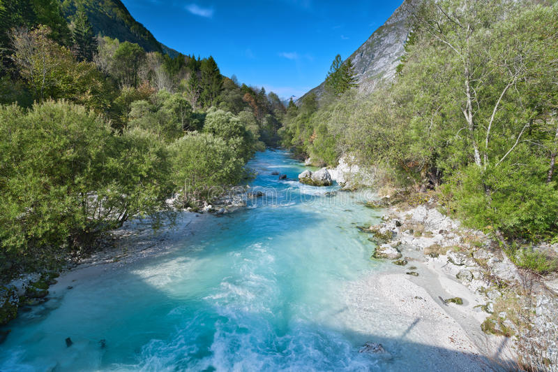 Beautiful turquoise mountain river Soca. Beautiful turquoise mountain river. Soca (Isonzo) river, Julian Alps, Slovenia. Popular touristic destination stock photography