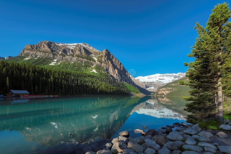 Llake Louise in Canadian Rockies, Banff National Park, Canada. Beautiful turquoise waters of the Lake Louise with snow-covered peaks above it in Rocky Mountains stock photography