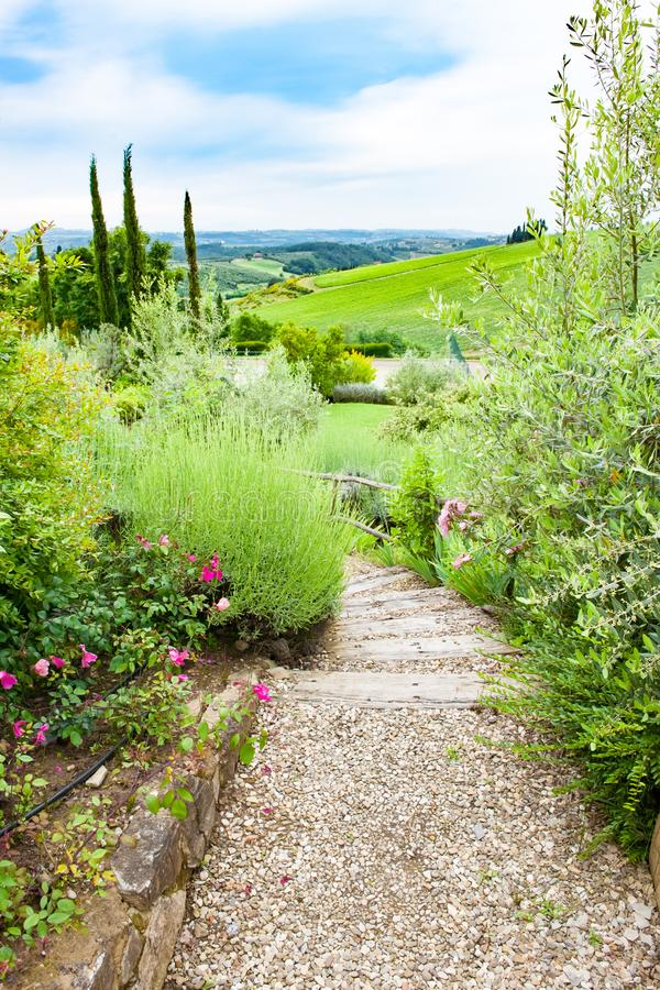 Beautiful Tuscan Landscape, steps from flowering garden into beautiful Tuscan Landscape royalty free stock image