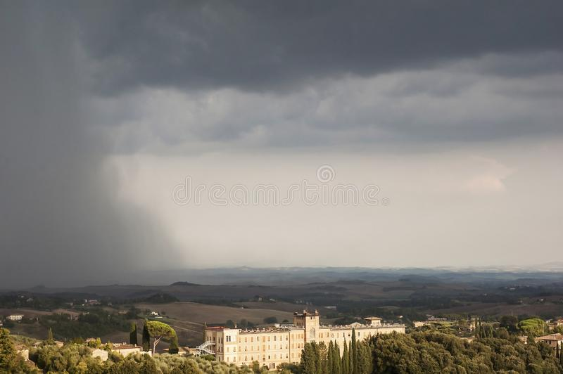 Storm over Siena, Tuscany, Italy. Beautiful Tuscan skyline with unusual stormy weather overhead and a strong rainbow visible. Siena is quickly becoming another royalty free stock photo