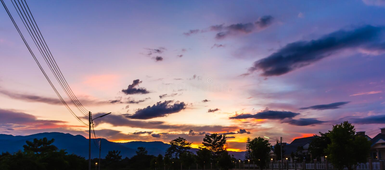 Beautiful twilight sky with mountain house and electric wire. royalty free stock photos