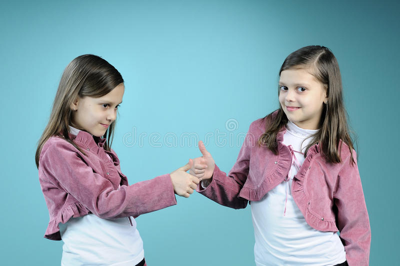 Download Beautiful Twin Sisters Showing Ok Sign Stock Image - Image: 13461551