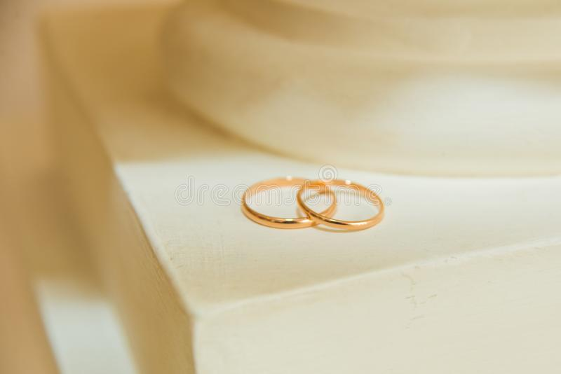 Beautiful two wedding gold rings on the surface. Wedding. Beautiful two wedding gold rings on the surface. Valentine`s day. Wedding stock photo