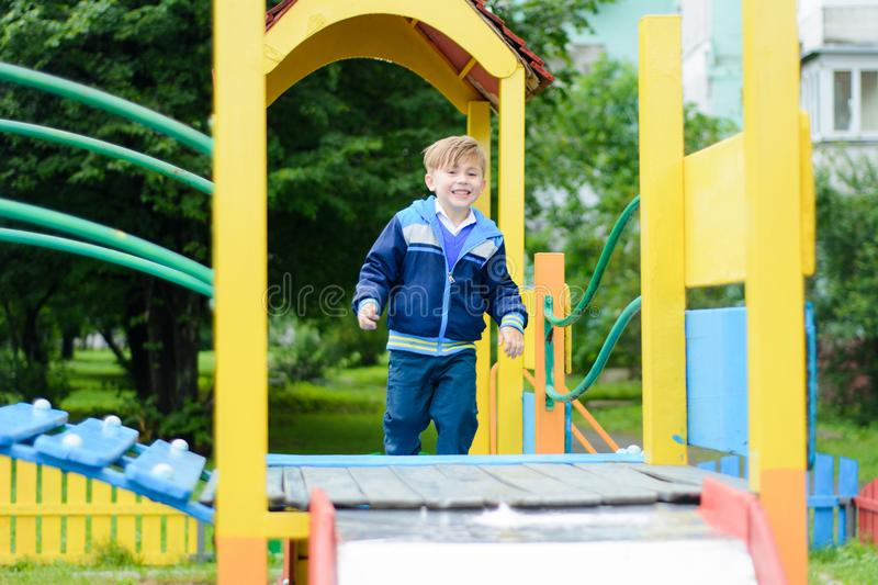 Funny children play on a children`s playground royalty free stock images