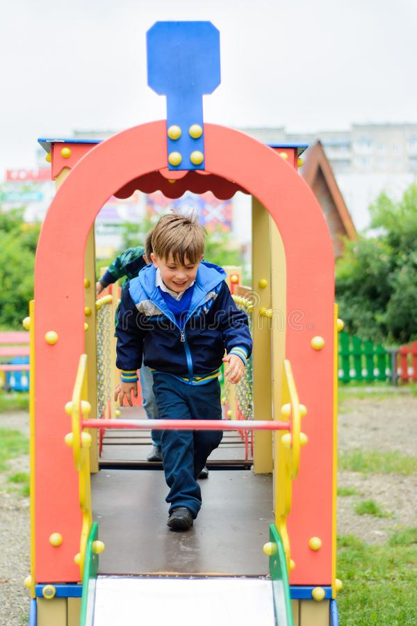 Funny children play on a children`s playground royalty free stock photos