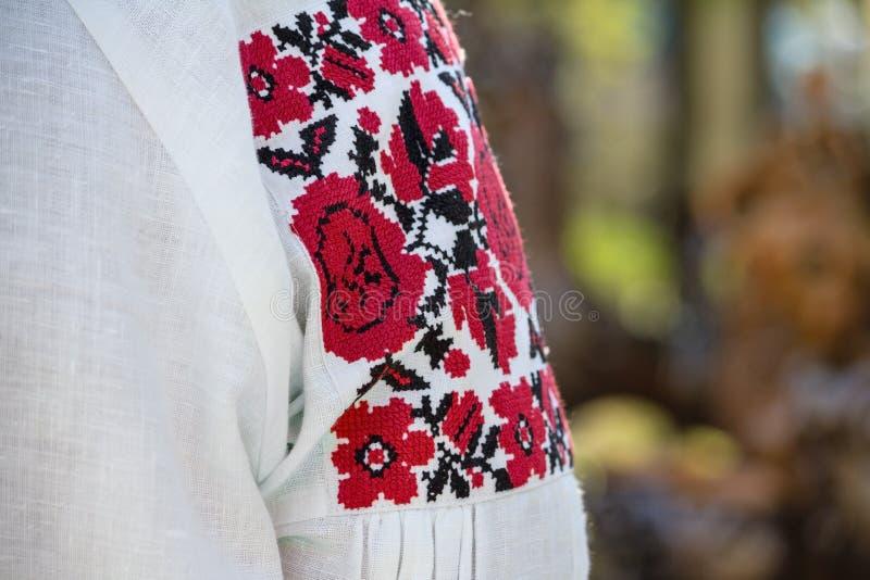 Beautiful Ukrainian embroidery on authentic women folk clothes stock image