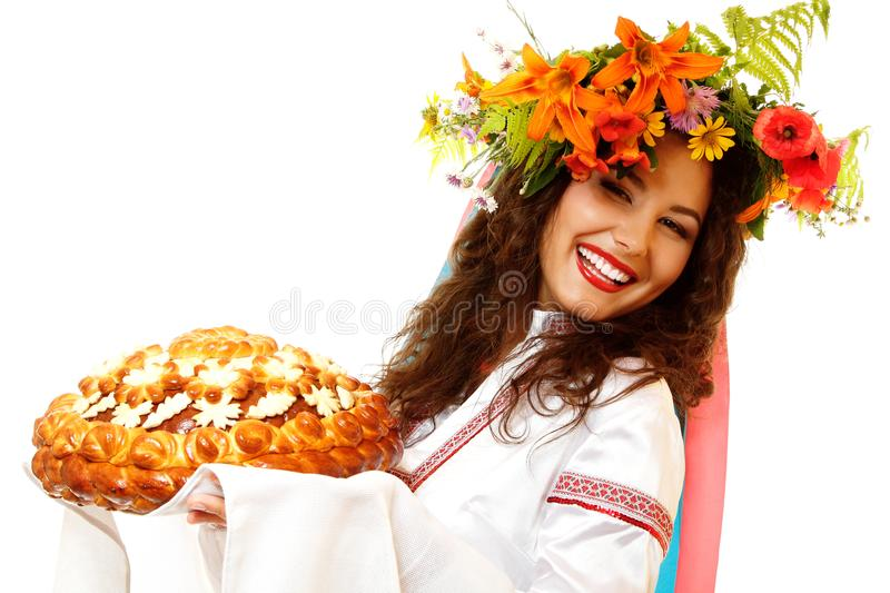 Beautiful ukrainian young hospitable woman in native costume by stock images