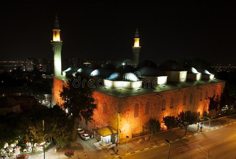 The beautiful Ulu Camii (Grand Mosque of Bursa) at nightime in Bursa in Turkey. The mosque was designed and built by architect Ali Neccar in 1396–1399 royalty free stock photography