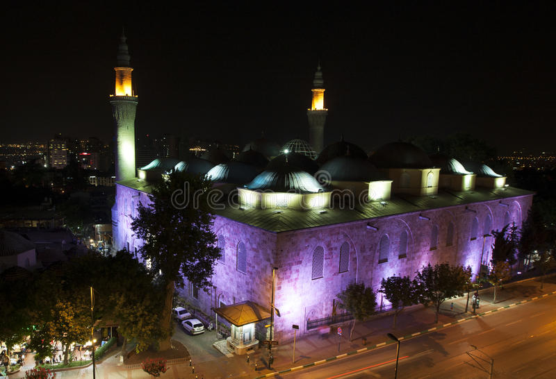 The beautiful Ulu Camii (Grand Mosque of Bursa) at nightime in Bursa in Turkey. The mosque was designed and built by architect Ali Neccar in 1396–1399 stock photo
