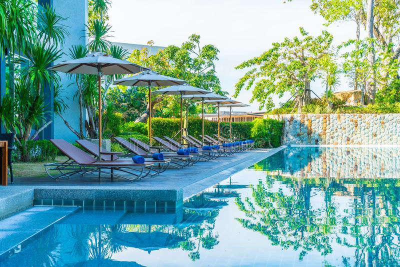 Beautiful umbrella and chair around swimming pool in hotel and resort. Vacation concept stock images