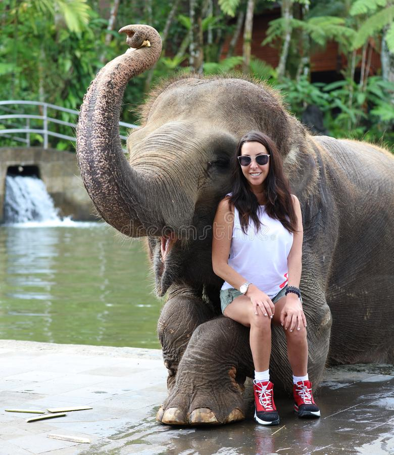 Beautiful unique elephant with girl at an elephants conservation reservation in Bali Indonesia stock image
