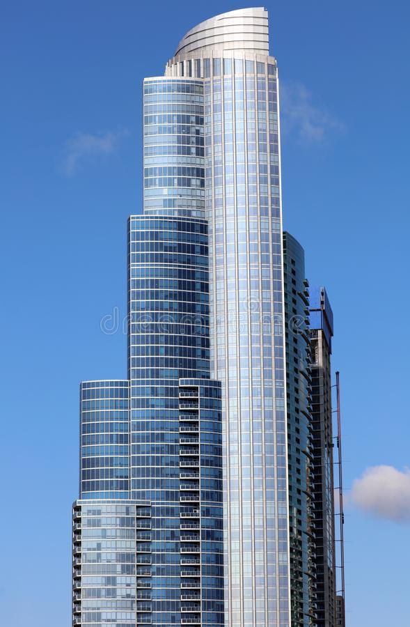 Beautiful unique skyscraper, modern building in the city of Chicago, Illinois. Blue glass architecture. stock photos