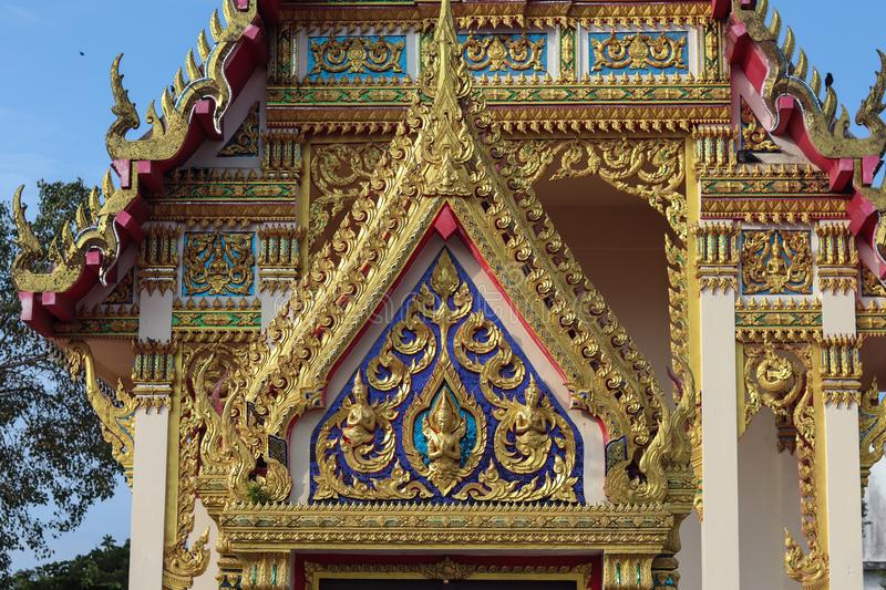 Beautiful and Unique Thai Buddha Temple. Beautiful gold and unique Thai Buddha style. Sun shine to a Temple. The color of architecture are gold, blue, red and stock photography