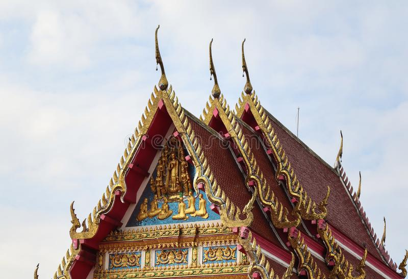 Beautiful and Unique Thai Buddha Temple. Beautiful gold and unique Thai Buddha style. Sun shine to a Temple. The color of architecture are gold, blue, red and stock images