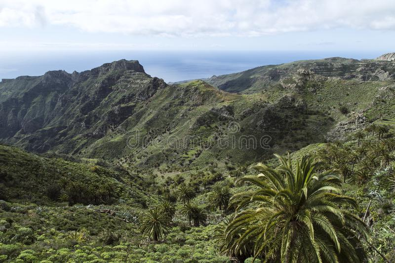 Views over the volcanic mountains of La Gomera. Beautiful almost untouched nature is one of the most important elements of La Gomera where many holiday goers stock image