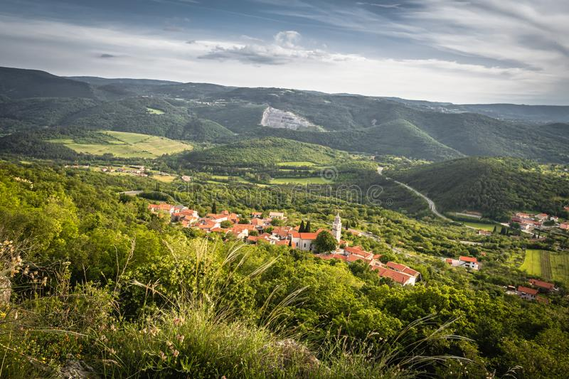 Beautiful upper view of village of crni kal in valley, on slovenian coast, in springtime. Beautiful upper view of village of crni kal in valley, on slovenian royalty free stock photos