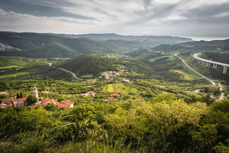 Beautiful upper view of village of crni kal in valley, on slovenian coast, in springtime. Beautiful upper view of village of crni kal in valley, on slovenian royalty free stock photography