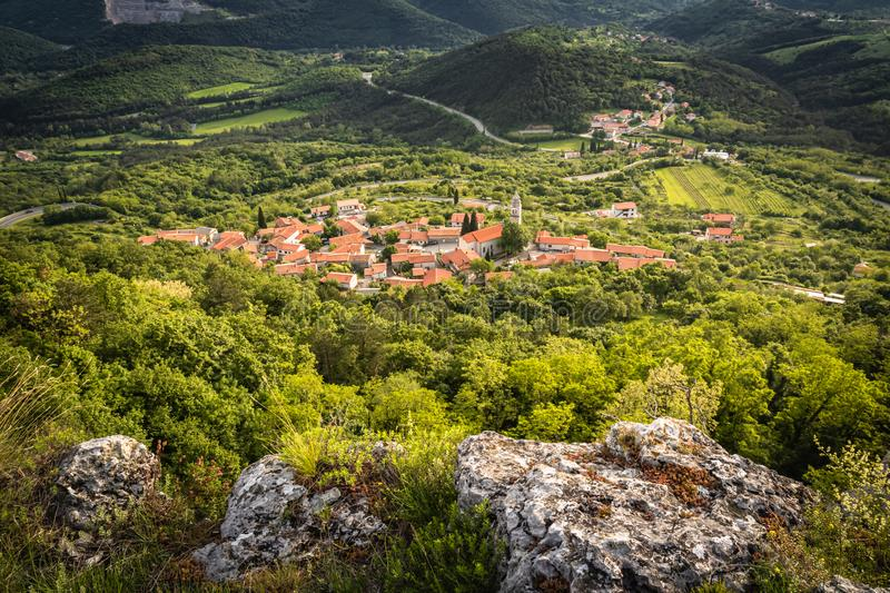 Beautiful upper view of village of crni kal in valley, on slovenian coast, in springtime. Beautiful upper view of village of crni kal in valley, on slovenian royalty free stock photo
