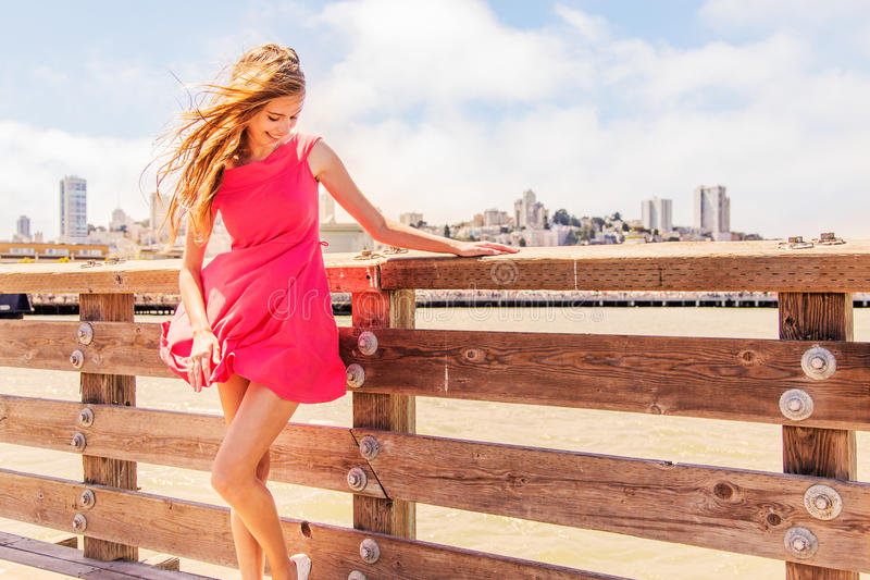 Beautiful urban woman, girl on pier stock images