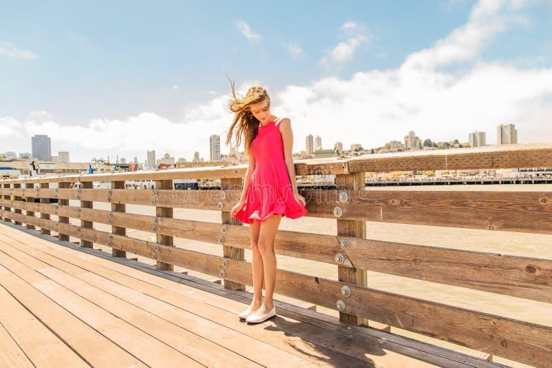 Beautiful urban woman, girl on pier stock photos