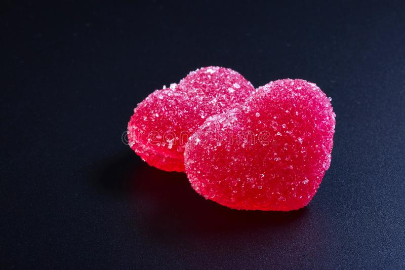 Beautiful valentines day background with red hearts on black background.  stock photography