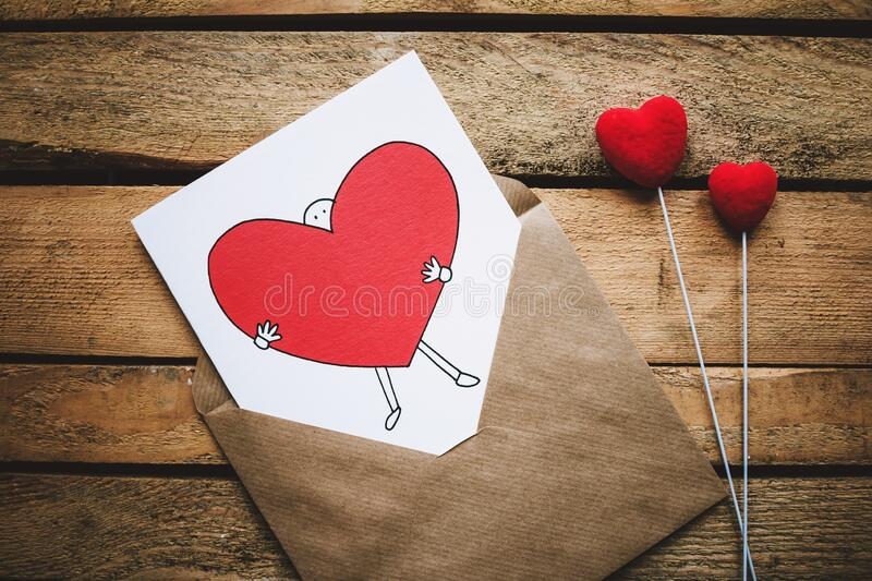 Heart shape made from ribbon on red stock photos