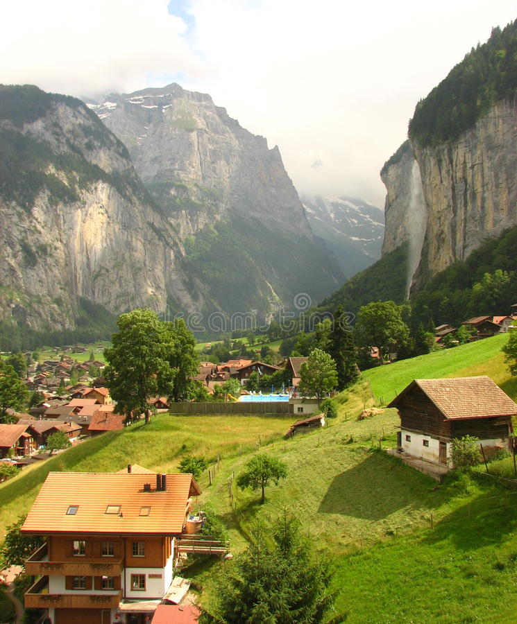 A beautiful valley: Lauterbrunnen, Switzerland. Beautiful Swiss valley with lush greenery and a waterfall and typical Swiss houses or chalets. i clicked this stock photos