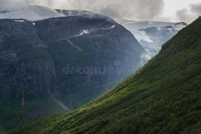 Beautiful valley in Norway with glacier and clouds stock photos