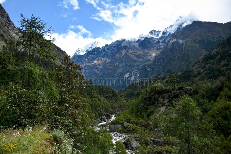 Beautiful of the valley, river and Himalayan Mountains on the way to Ghunsa, Nepal royalty free stock photography